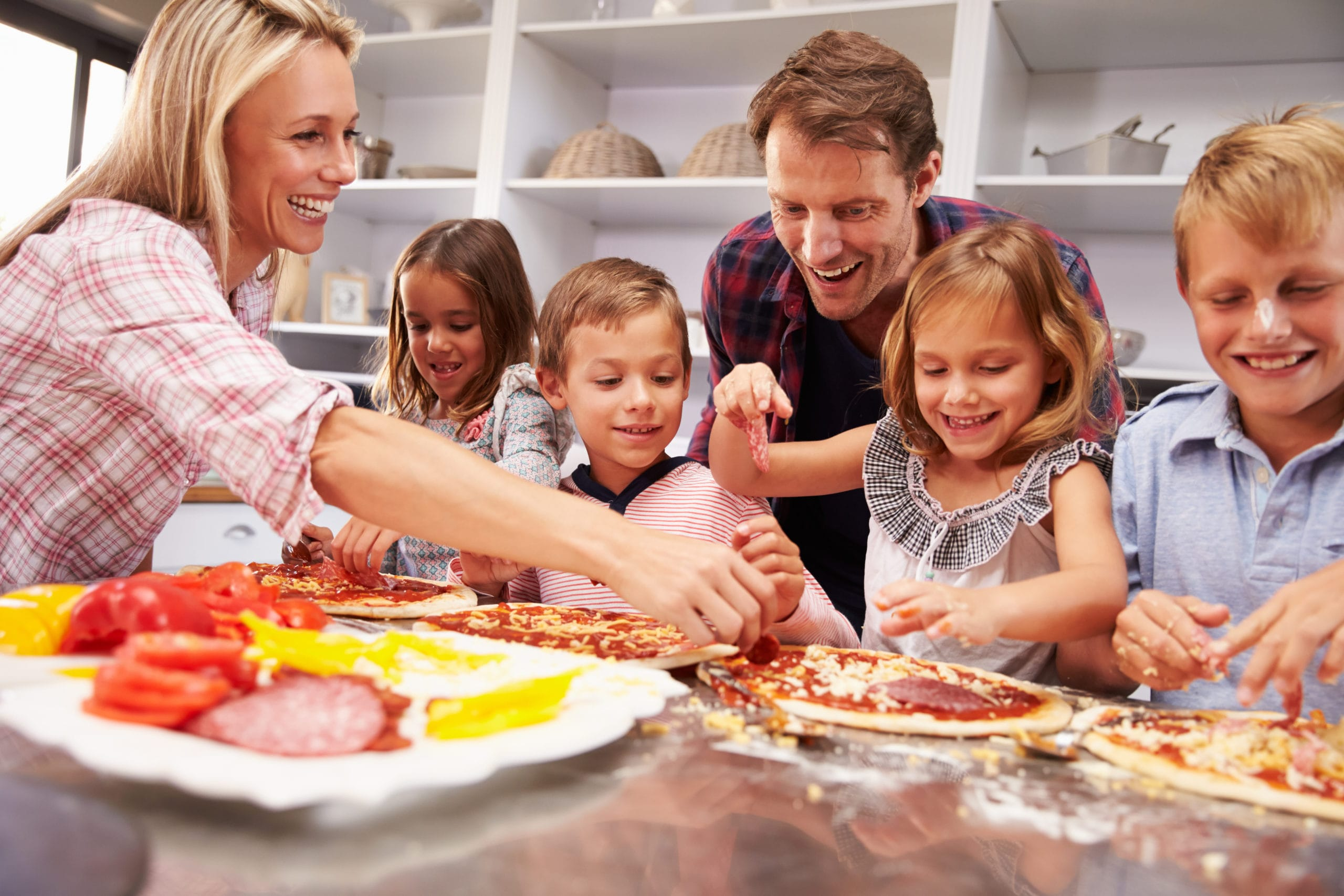 A family cooks dinner together